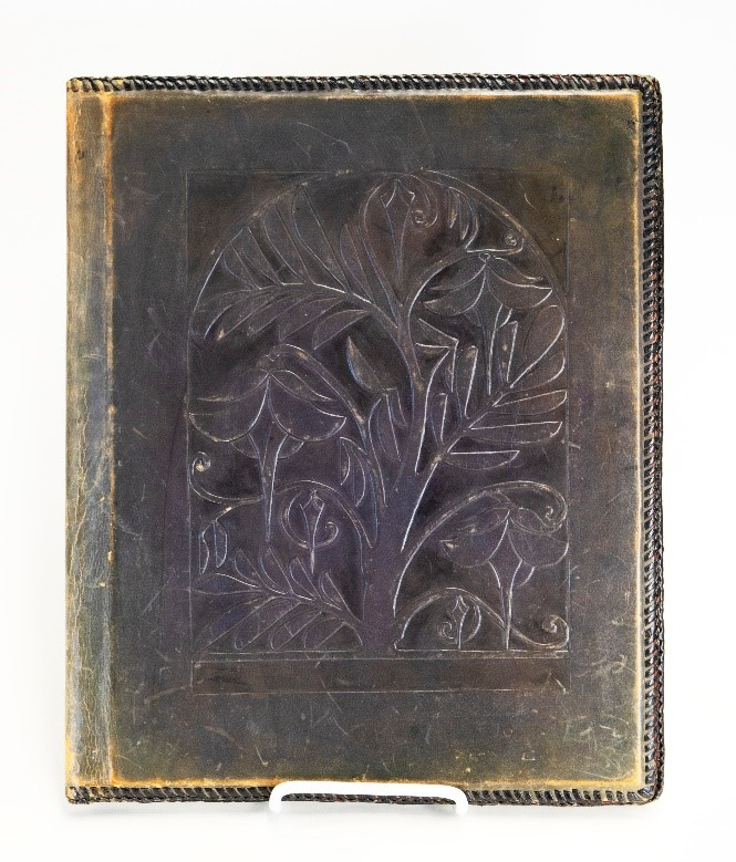 A tooled leather portfolio handmade by Helen