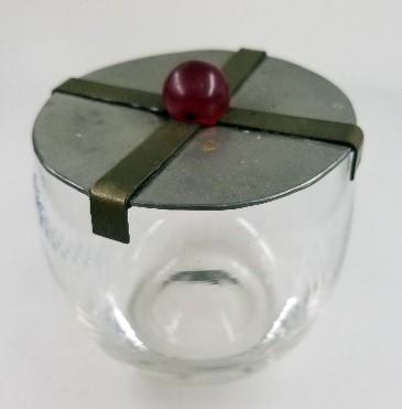 A metal jam pot lid handmade by Helen
