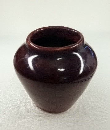 A red glazed vase handmade by Helen